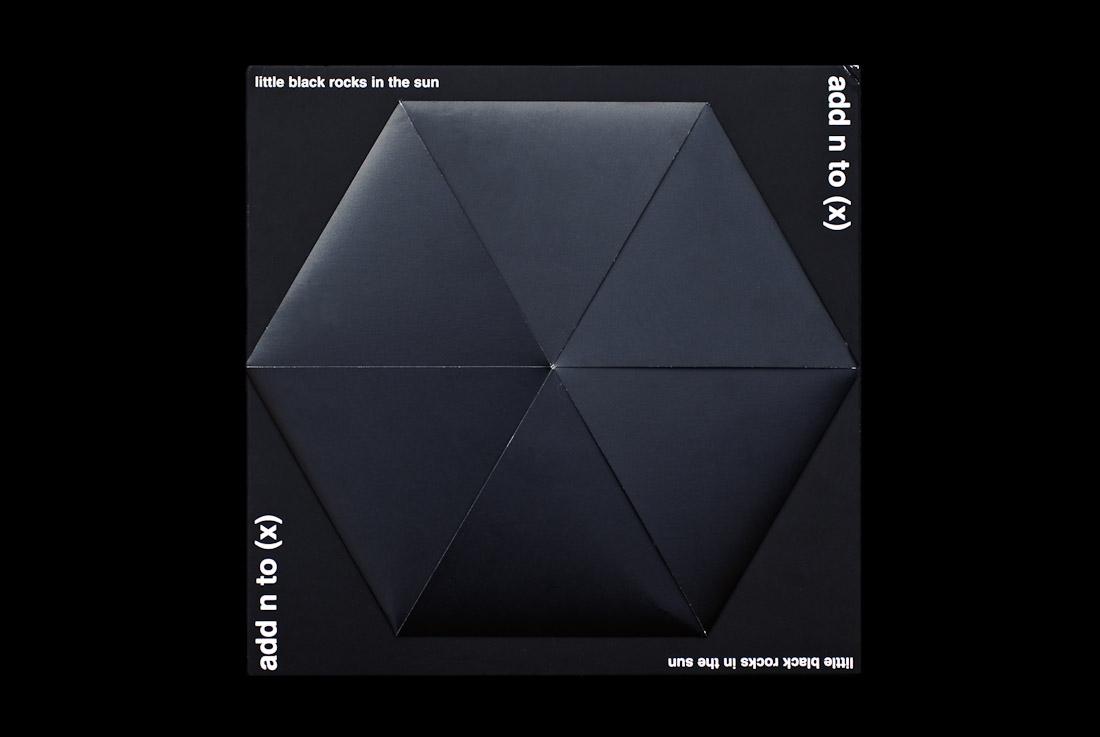Add N to (X) - Little Black Rocks In The Sun